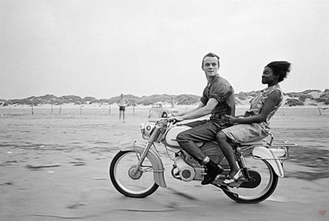 vintage_couple_motorcycle_riding_beach