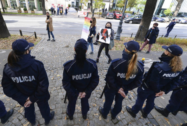 "Pro-choice activists from ""Women Strike"" attend a protest in front of Poland's constitutional court, in Warsaw, Poland, Thursday, Oct. 22, 2020. Poland's top court has ruled that a law allowing abortion of fetuses with congenital defects is unconstitutional. The decision by the country's Constitutional Court effectively bans terminating pregnancies in cases where birth defects are found and will further limit access to abortions in Poland. (AP Photo/Czarek Sokolowski)"